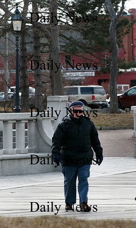 Newburyport: Reverend Richard Parker takes a walk along the boardwalk in Newburyport Monday afternoon, despite the wind and the cold. Photo by Ben Laing/Staff Photo