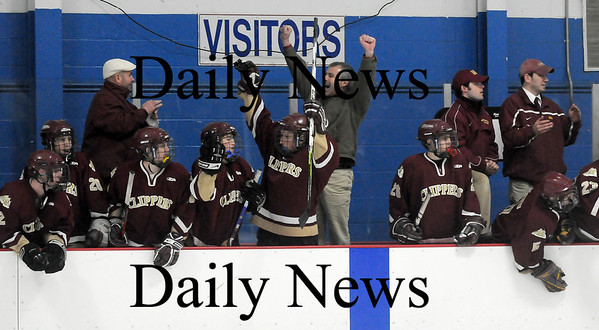 Stoneham: The Newburyport bench erupts in celebration after the Clippers added an empty netter at the end of their game against Tewksbury. Newburyport won the game 7-4 and advance to the North Sectional Final game on Thursday. Photo by Ben Laing/Newburyport Daily News Tuesday March 3, 2009.