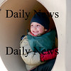Newburyport: Silas Cash, 4, of Newburyport, hangs out inside the tube at the tot lot on Inn Street Friday afternoon. Photo by Ben Laing/Staff Photo