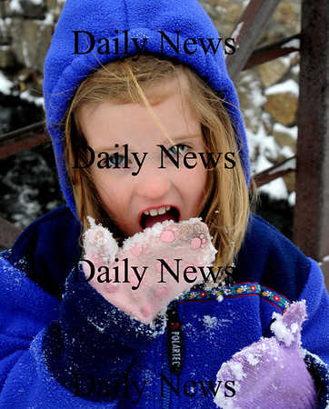 Amesbury:<br /> Samantha Jordan, 4, gets a taste of freshly fallen snow at Amesbury's Upper Millyard. She was there with her brother, Connor, 2, and father, Tom, checking out the ducks that take up residence there.<br /> Photo by Bryan Eaton/Newburyport Daily News Monday, March 02, 2009