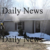 Merrimac:<br /> Firefighters quickly put out a smoky fire that started in the basement of this home at 8 Abbott Street in Merrimac on Monday morning. Nobody was injured the blaze.<br /> Photo by Bryan Eaton/Newburyport Daily News Monday, March 16, 2009