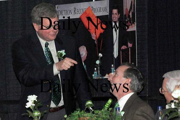 Newburyport:<br /> Mayor John Moak jokes to David Tibbett's to start being nice.<br /> Photo by Bryan Eaton/Newburyport Daily News Tuesday, March 17, 2009