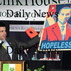 "Newburyport:<br /> Sen. Steve Baddour shows a poster of Governor Duval Patrick playing off President Obama's campaign of ""hope.""<br /> Photo by Bryan Eaton/Newburyport Daily News Tuesday, March 17, 2009"