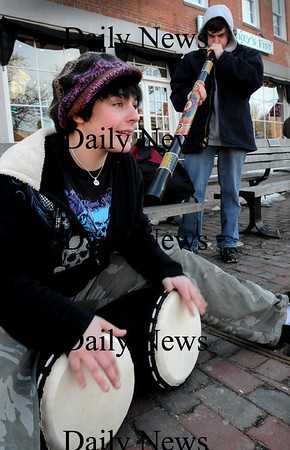 Newburyport:<br /> Melissa Derrico, 16, with her d'jembe drums, left, and Alex Gagnon, 17, with a didgeridoo, both of Newburyport practice their music in Newburyport's Market Square on Thursday afternoon. The two, who have a big interest in different music, play around different spots in the city, especially when the weather is nicer.<br /> Photo by Bryan Eaton/Newburyport Daily News Thursday, March 12, 2009