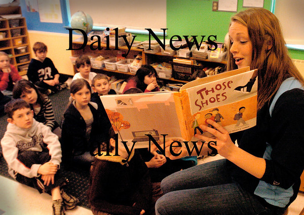 "Newbury:<br /> Triton's track team will read to Newbury Elementary School students a book called ""Those Shoes"", which is about a poor young child who wants a pair of athletic shoes, here Deanna Latham with third-graders. This is being done in conjunction with a drive to collect athletic shoes for inner-city kids.<br /> Photo by Bryan Eaton/Newburyport Daily News Tuesday, March 24, 2009"