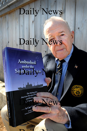 "Newburyport:<br /> George Duffy with his new book, ""Ambushed Under the Southern Cross.""<br /> Photo by Bryan Eaton/Newburyport Daily News Wednesday, March 25, 2009"