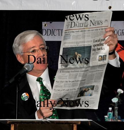 """Newburyport:<br /> Charlie Cullen mentions a story from the Daily News about Sen. Steve Baddour and Rep. Michael Costello expensing some meals then sang to the tune of the Beatle's song """"Eight Days a Week"""" to """"Eight Meals a Week.""""<br /> Photo by Bryan Eaton/Newburyport Daily News Tuesday, March 17, 2009"""