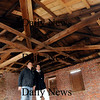 Newburyport:<br /> Contractor Steve MacDonald, left, show Cushing House Museum curator Jay Williamson repairs made to the roof of the old mint building.<br /> Photo by Bryan Eaton/Newburyport Daily News Thursday, March 19, 2009