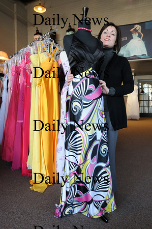 Newburyport:<br /> Jeanine Hines, owner of Pure Bliss, said many of this year's prom dresses are prints and bright colors.<br /> Photo by Bryan Eaton/Newburyport Daily News Wednesday, March 25, 2009