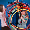 "Amesbury:<br /> Annie Cronin, left, and Maddie Ziomek, both 6, put away the hoola hoops after their class used them in gym class at the Amesbury Elementary School on Monday afternoon. They then did and aerobic tag game called ""Hide from the Leprechaun.""<br /> Photo by Bryan Eaton/Newburyport Daily News Monday, March 16, 2009"