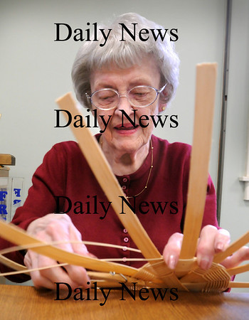 Amesbury:<br /> Ida Phillips of Amesbury weaves a basket at the Amesbury Senior Center on Thursday morning. Irene Kimbrell teaches the class each week attended by four or five participants, that change occasionally.<br /> Photo by Bryan Eaton/Newburyport Daily News Thursday, March 19, 2009
