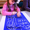 Salisbury:<br /> Marena Crivello, 4, uses a stencil to draw a picture of a doctor in Julie Deschenes preschool class at Salisbury Elementary School on Tuesday morning. The children were learning about the different jobs people have.<br /> Photo by Bryan Eaton/Newburyport Daily News Tuesday, March 31, 2009