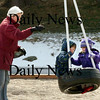 Amesbury:<br /> With snow still in the back, Eileen Flick of Dover, N.H. pushes a tire swing with her granddaughter Carly Gendell, 4, right, and Teddy Batmaca, 3, both of Amesbury at the Amesbury Town Park on Thursday afternoon. The two have been best friends since they were a little over one year-old said Teddy's mother, Kristin Noon-Batmaca who was nearby.<br /> Photo by Bryan Eaton/Newburyport Daily News Thursday, March 12, 2009