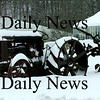 Salisbury:<br /> An old farm tractor sits covered with snow at Bartlett's Farm Stand in Salisbury after yesterday's snowstorm. It won't be long before a later model tractor will begin plowing the adjacent fields.<br /> Photo by Bryan Eaton/Newburyport Daily News Monday, March 02, 2009