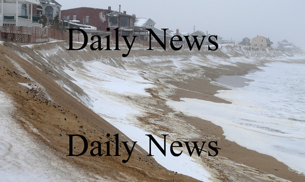 Newbury:<br /> Yesterday's storm didn't create any serious waves to test the covered sand bags at the center of Plum Island. The photo, taken at high tide, shows the waves not too close to homes there.<br /> Photo by Bryan Eaton/Newburyport Daily News Monday, March 02, 2009