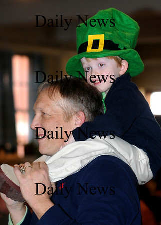 Newburyport:<br /> Charlie Costello, 3, sits on his dad, Nicholas, as they watch members of the Duffin-Murphy School of Irish Dance perform.<br /> Photo by Bryan Eaton/Newburyport Daily News Tuesday, March 17, 2009