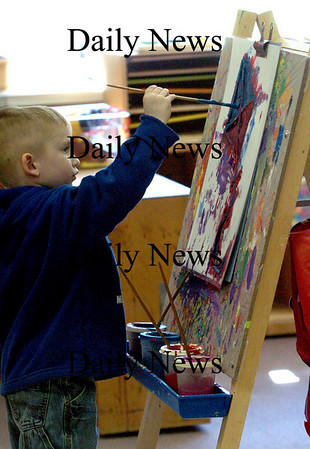 Rowley:<br /> Ryan Shrader, 5, paints a kite using a stencil in Julie Rowe's preschool class at the Pine Grove School on Wednesday afternoon. The children were painting spring-themed photos.<br /> Photo by Bryan Eaton/Newburyport Daily News Wednesday, March 25, 2009