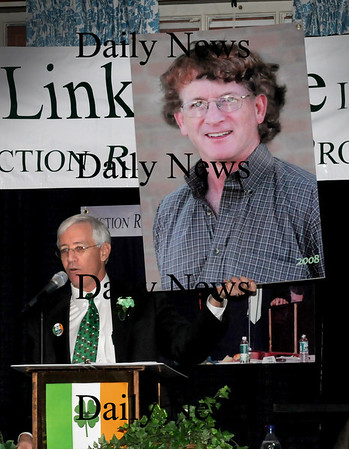 Newburyport:<br /> Charlie Cullen shows a composite photograph of Newburyport City Councilors Larry McCavitt and James Shanley for a gag during yesterday's St. Patrick's Day Luncheon.<br /> Photo by Bryan Eaton/Newburyport Daily News Tuesday, March 17, 2009