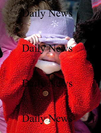 Salisbury:<br /> Grace McLellan, 7, peeks out from under her bundle of clothing during a cold recess at Salisbury Elementary School yesterday as the first-graders went for brisk walk for excercise. Temperatures rise today but with winds still blowing with more warming on the way as the week goes on.<br /> Photo by Bryan Eaton/Newburyport Daily News Monday, March 23, 2009