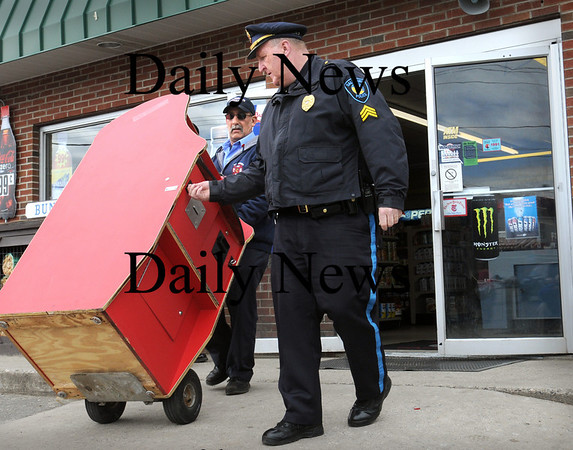 Salisbury:<br /> Salisbury Fire Dept. Lt. Tim Oliveira, left, and Sgt. Kevin Sullivan of the Salisbury Police Dept. roll one of two gaming machines allegedly used for illegal gambling at the Richdale in Salisbury Square. Several other businesses in town were raided as well.<br /> Photo by Bryan Eaton/Newburyport Daily News Tuesday, March 31, 2009