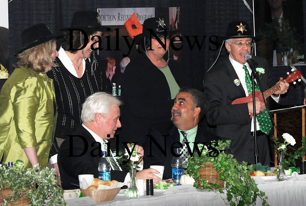 Newburyport:<br /> Sheriff Frank Cousins laughs, with D.A. Jonathan Blodgett, left, as he is spoofed by, from left, Ann Ormond, Cindy Johnson, Esther Sayer and Charlie Cullen all donning deputy sheriff hats.<br /> Photo by Bryan Eaton/Newburyport Daily News Tuesday, March 17, 2009