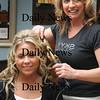 Salisbury:<br /> Annmarie Lewis of SKYY tries a hairstyle on Triton High senior Alex DeHetre, 18.<br /> Photo by Bryan Eaton/Newburyport Daily News Wednesday, March 25, 2009
