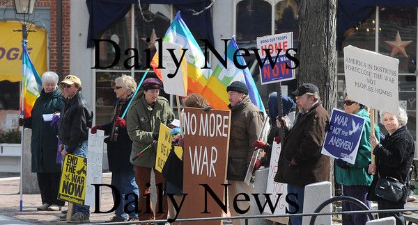 Newburyport: The weekly peace rally in Market Square gather on the 6th anniversary of the start of the Iraq War. Jim Vaiknoras/staff photo