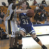 Boston:Georgetown'sKelly Gillen powers her way for two aginstNyesha Kelley during the Royals North Finals victory over New Mission at Emmanuel College in Boston.photo by Jim Vaiknoras March 7 2009
