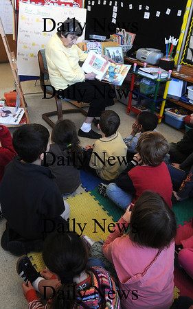 Newburyport: Florina Comeau, a resident at Artia Merrimac Place reads to 1st graders in Janice Green's class at the Bresnahan School. Once a month resdients get together with the students to help with their reading.photo by Jim Vaiknoras. Newburyport Daily News. March 5, 2009