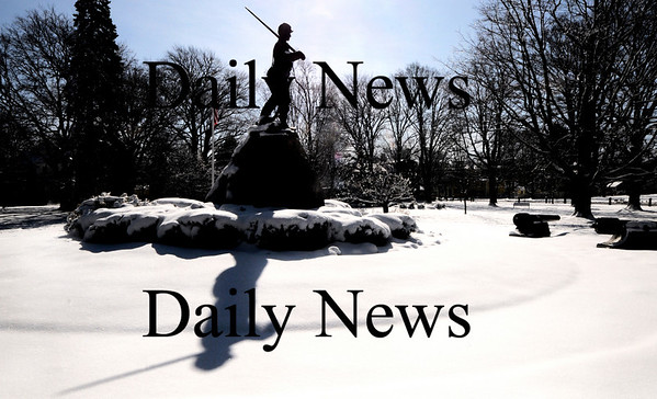 Newburyport:The Civil War statue at Atkinson Common casts a shadow on yesterdays snow in this mornings bright sunshine. Jim Vaiknoras/Staff photo