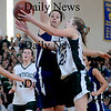Boston: Pentucket's Holly Jakobson slices in for two during the Sachems 61-46 loss to Swampscott in the North final at Emmanuel College in Boston Saturday photo by Jim Vaiknoras March 7, 2009