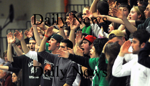 Methuen:Pentucket's fans do the tomahawk chop during the Sachems 38-27 win over St Mary's at Methuen High Thursday night. photo by Jim Vaiknoras Newburyport Daily News, Thursday March 5, 2009