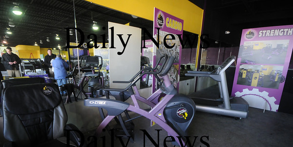 Newburyport: Employees at the soon to be opened Planet Fitness conduct an early sign up at their Port Plaza in Newburyport location.photo by Jim Vaiknoras. Newburyport News, February 3, 2009