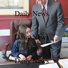 Newburyport: Olivia Iannini, 8, goes over some city business with Mayor Moak at his office. Olivia is a student at the Bresnahan School and won a chance to spend the afternoon with the Mayor.photo by Jim Vaiknoras. Newburyport Daily News. March 5, 2009
