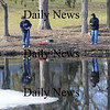 Newbury:Andrew Frain and Carmen Freni both of Malden try their luck fishing near the fish ladder on Central Street in Newbury Sunday afternoon.photo by Jim Vaiknoras. Newburyport Daily News  Sunday March 8, 2009