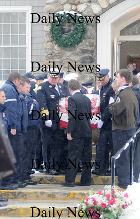 West Newbury: A flag draped casket containing the remains of Richard Berkenbush exits West Newbury Congregational Church past an honor guard of public safety officials after his funeral Monday morning.Jim Vaiknoras/staff photo