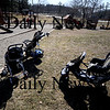 Amesbury: Baby strollers rest at Amesbury park as kids play on the first day of spring. Jim Vaiknoras/Staff photo