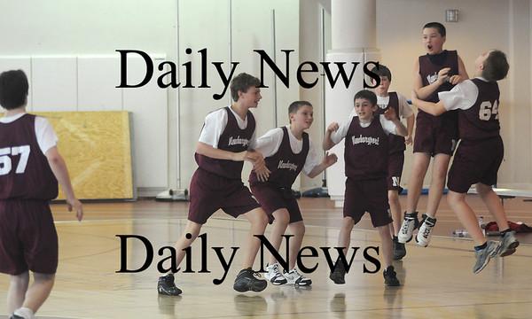 Newburyport: The Newburyport Boys Basketball Association 8th grade champions celebrate their 57-54 win over the Piston Sunday at Newburyport High.Jim Vaiknoras/staff photo