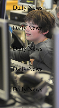 Salisbury: Ryan LeBlanc, a  student in Graham Eaton's 4th grade class at the Salisbury Elementary school, works in computer class on an animal project Tuesday.His project was on spider monkeys.photo by Jim Vaiknoras/Newburyport Daily News. Tuesday March 3, 2009