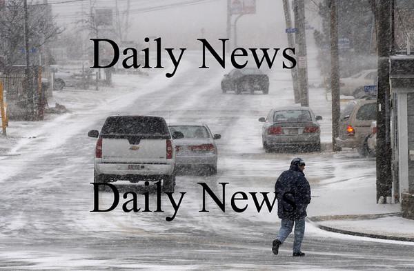 Newbury: A aman hurries across teh Plum Island Turnpike Sunday morning as a lite snow begins to fall.photo by Jim Vaiknoras, Newburyport Daily News, Saturday February 28, 2009