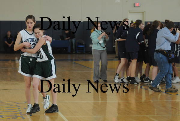Boston: Pentucket's Holly Parker is consoled by teammate Abby Stephenson after the Sachems 61-46 loss to Swampscott in the North final at Emmanuel College in Boston Saturday photo by Jim Vaiknoras March 7, 2009