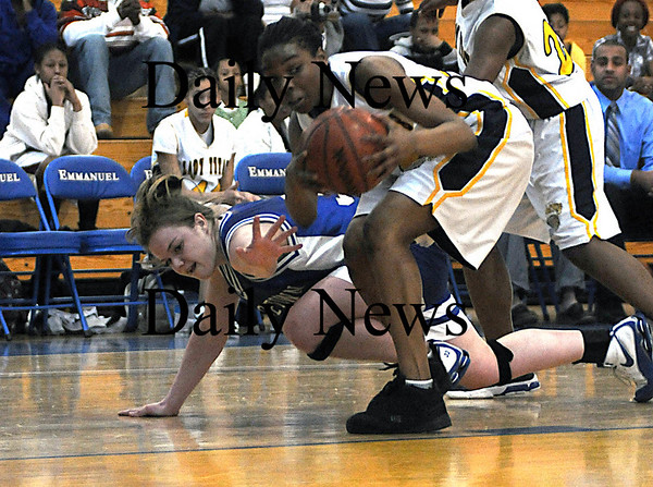 Boston:Georgetown's Taryn O'Connell reaches for a loose ball during the Royals North Finals victory over New Mission at Emmanuel College in Boston.photo by Jim Vaiknoras March 7 2009