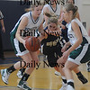 Boston: Pentucket's Holly Jakobson and Emily Lane fight for a loose ball with Tara Gallagher during the Sachems 61-46 loss to Swampscott in the North final at Emmanuel College in Boston Saturday photo by Jim Vaiknoras March 7, 2009