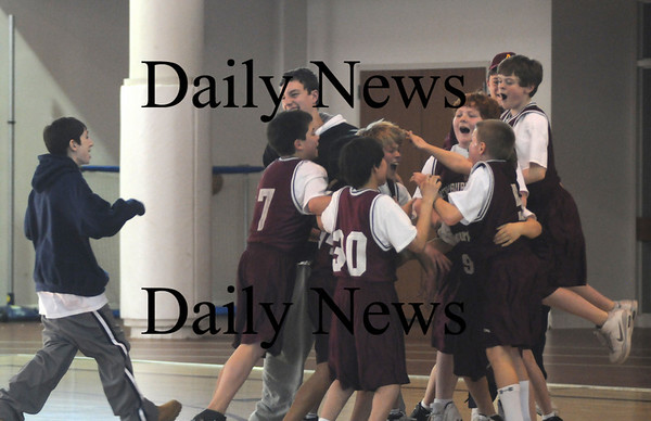 Newburyport: The Jayhawks celebrate their 55-53 victory over the Buckeyes in the championship game at the Saturday at Newburyport High.Jim Vaiknoras/Staff Photo