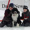 Newburyport; Jackson Sidford, 9, and his brother Sam, 8,play with their dog Dublin at their Newburyport home. Dublin is a Portuguese Water Dog, the same breed the First Family is getting.photo by Jim Vaiknoras, Newburyport Daily News, Saturday February 28, 2009