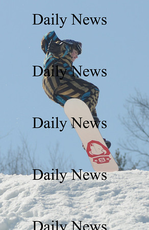 Amesbury: Austin Stevens catches some air at the Big Air Snowboarding compitition at Amesbury Sports Park Saturday.Jim Vaiknoras/Staff photo