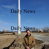 Newburyport:Mark Richey owner of Mark Richey poses infront of the wind turbine at his business. Jim Vaiknoras/staff photo