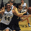 Methuen:Pentucket's Andrea Attenasio gets tangled up with St Mary's Cassi Amenta during the Sachems 38-27 win at Methuen High Thursday night. photo by Jim Vaiknoras Newburyport Daily News, Thursday March 5, 2009