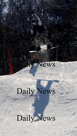 Amesbury: Marty Balin cast a long shadow as he flies of the jump at Amesbury Sports Park Saturday in the first Big Air Snowboarding event.Jim Vaiknoras/Staff photo