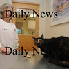 Amesbury: Veterinarian Dr Cindy Wojcicki of the Merrimack Valley Animal Hospital and Tydye the cat who lives in the office and is a bit over wieght.Jim Vaiknoras/staff photo